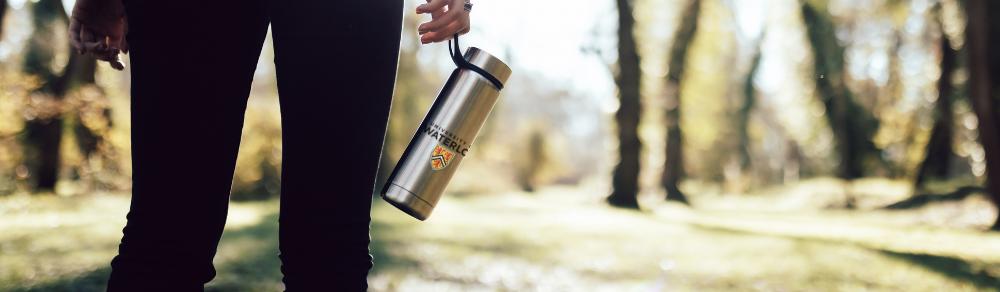 Person walking with University of Waterloo reusable water bottle