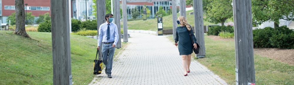 students walking on campus wearing masks