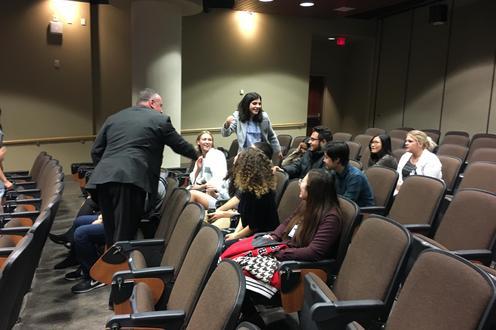 Ross Johnston congratulates students