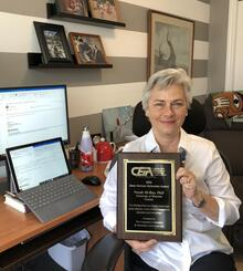 Norah McRae, Associate Provost for Co-operative Experiential Education, with her CEIA Award