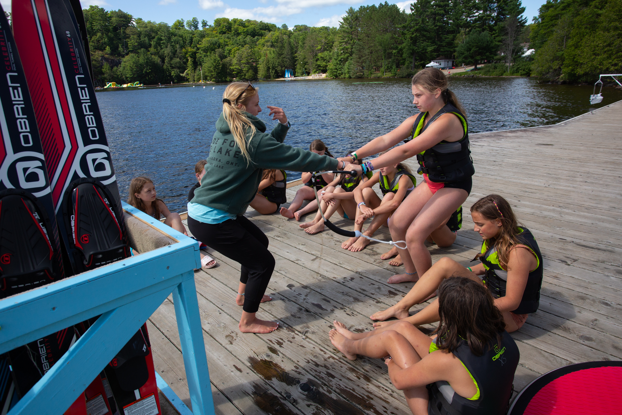 University of Waterloo co-op student demonstrating how to wakeboard to campers at Muskoka Woods