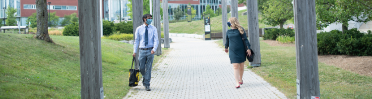 students walking on campus with masks
