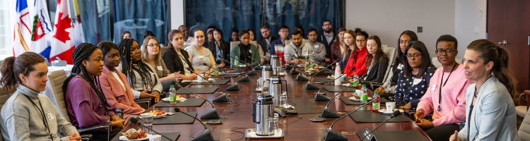 co-op students sitting at a government board room table