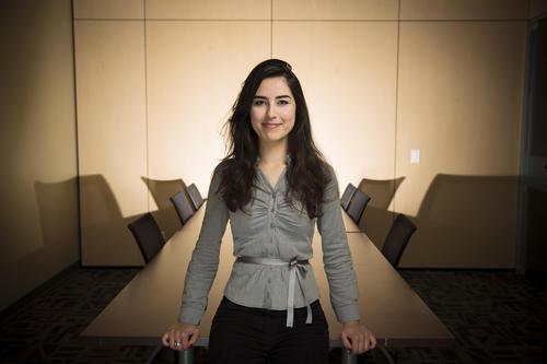 Girl looking like a boss in a board room