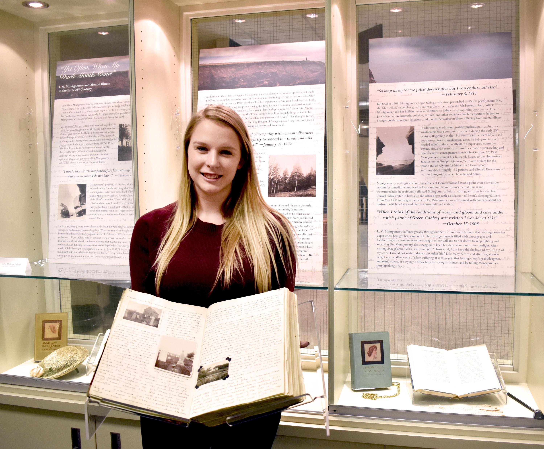 Jenna Philbrick holding Montgomery's Journal