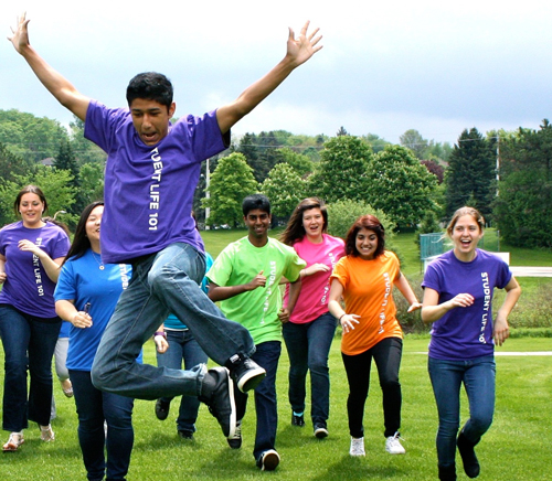 Students jumping and running