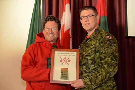Prof. Lackenbauer receives his honorary appointment from Major Craig Volstad.