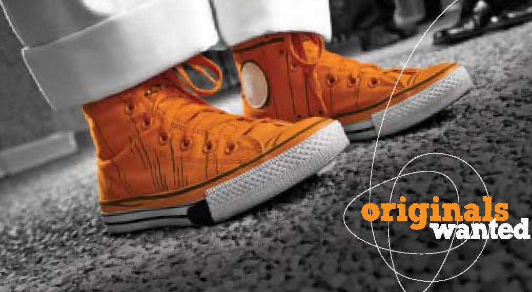 "Pair of orange sneakers with text that reads ""Originals Wanted"""