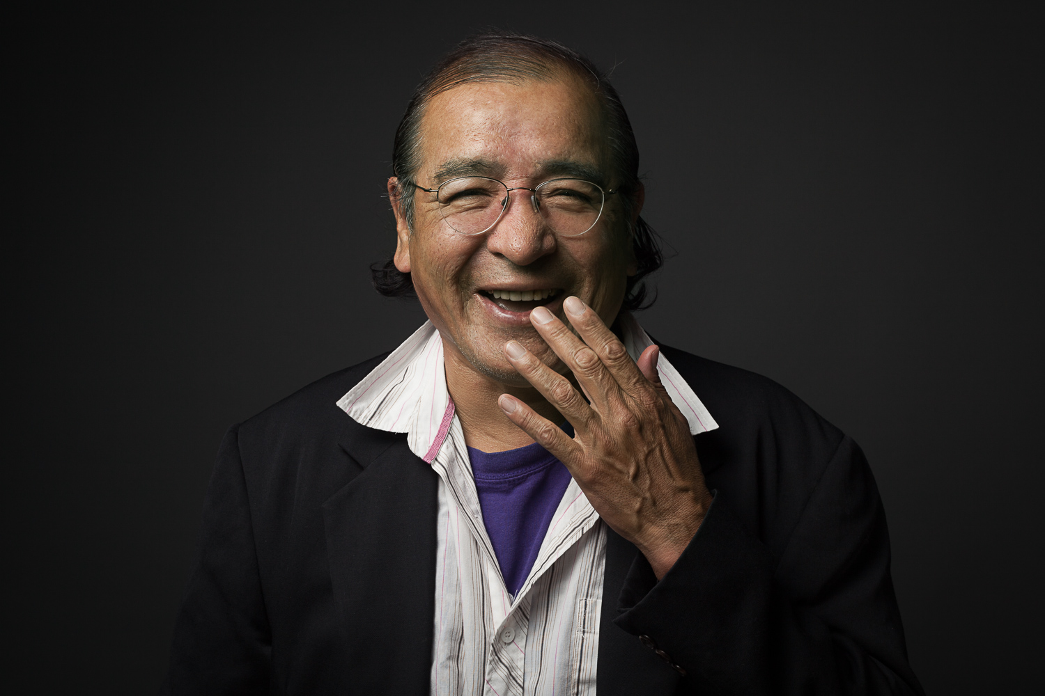 Tomson Highway laughing (portrait by Sean Howard)