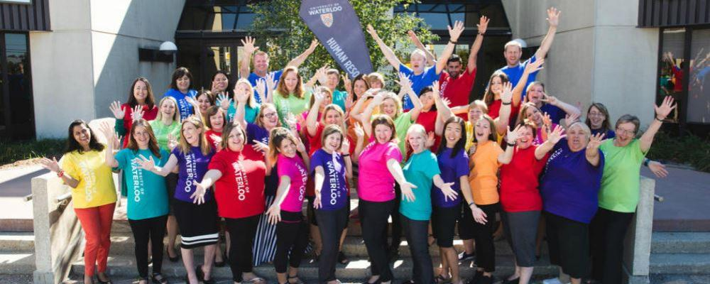 Human Resources staff celebrating with arms in the air