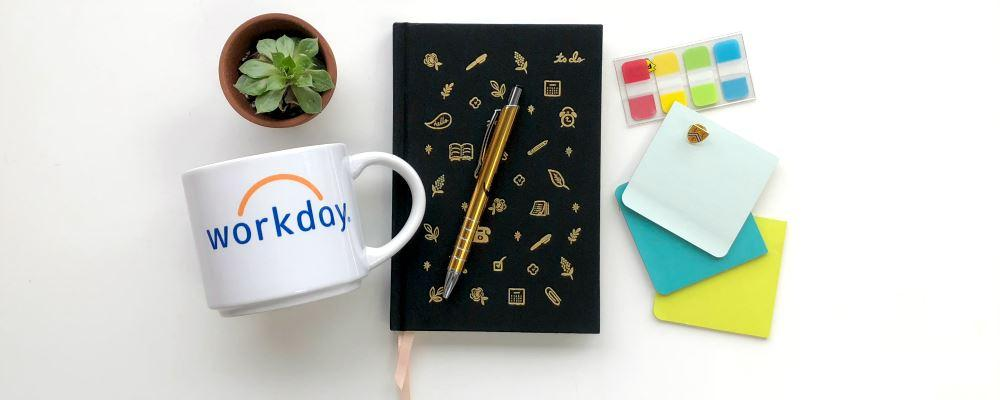 Workday mug with stationary items