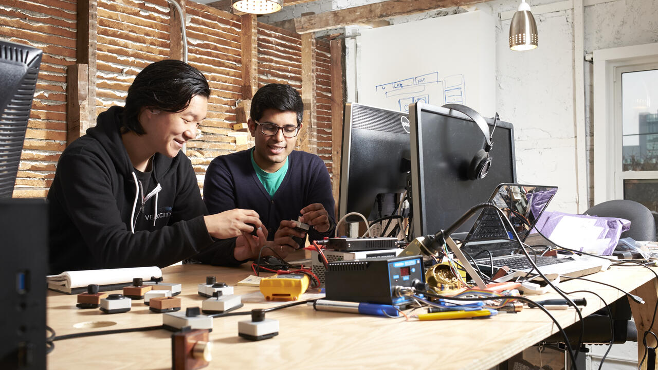 Co-founders work together in the Velocity Garage