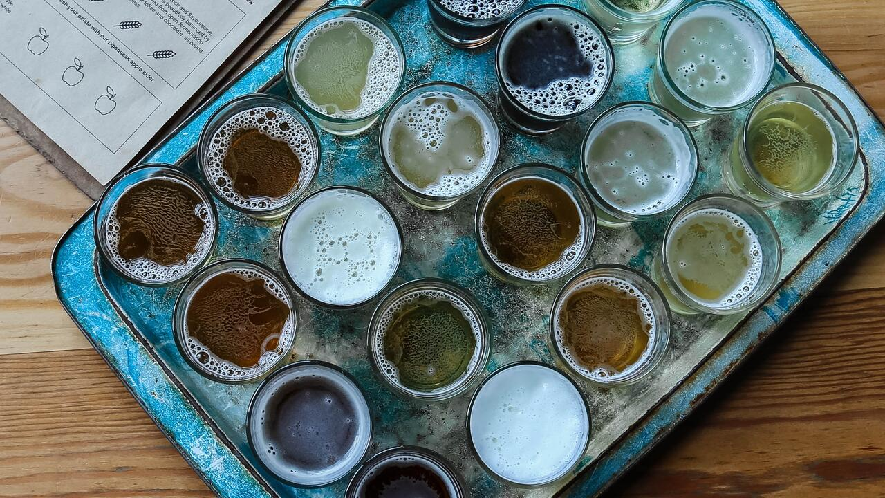 Tray of glasses, filled with frothy beer