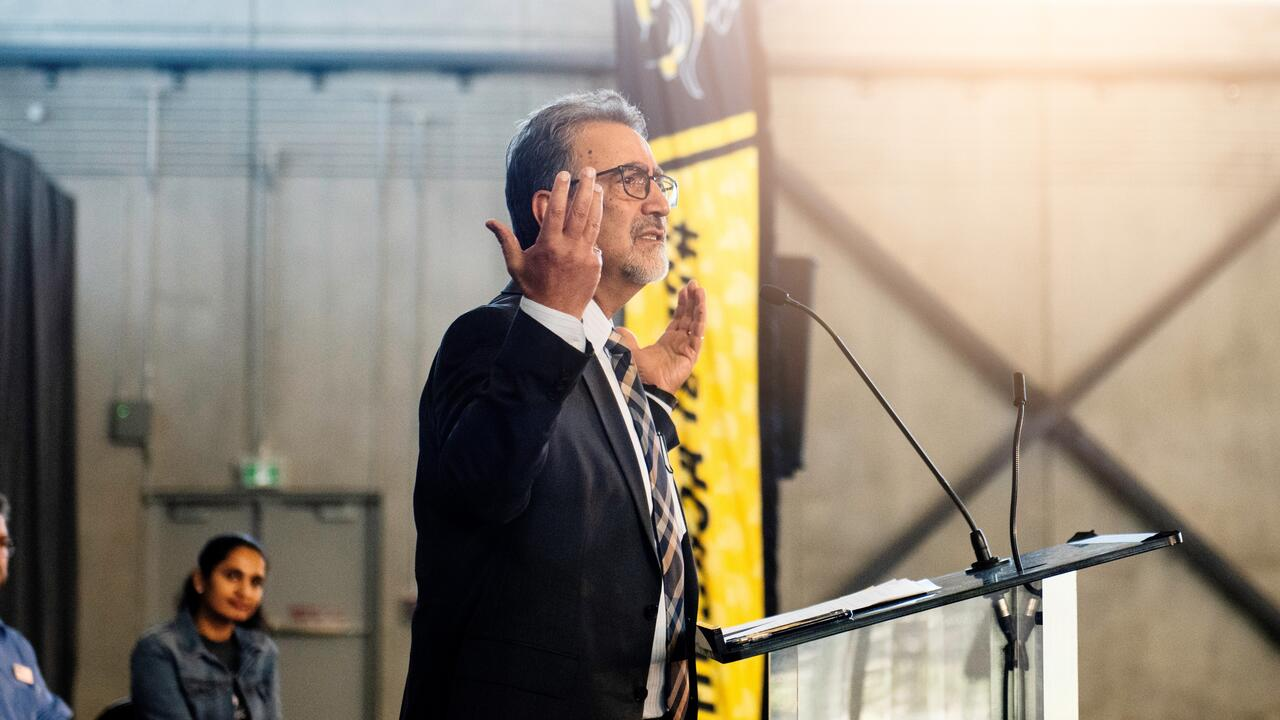 Feridun Hamdullahpur speaks at the grand opening of the Field House in 2019