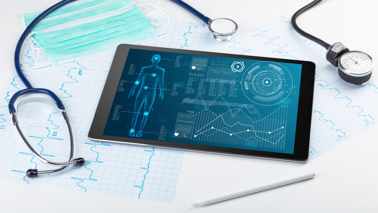 body scanning technology on a laptop surrounded by medical instruments