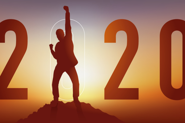 triumphant figure on a mountaintop with 2020 in background