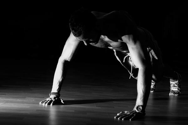 Black and white photo of man in full pushup position