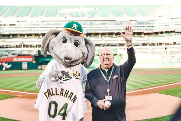 Dick Callahan poses for a photo with the Oakland A's mascot
