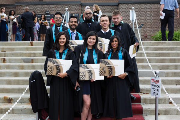 Group photo on steps at convocation.