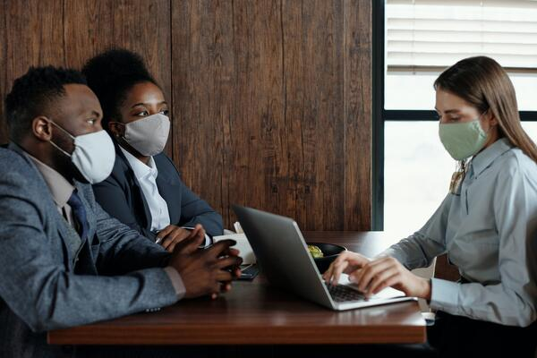 Workers meet with masks on