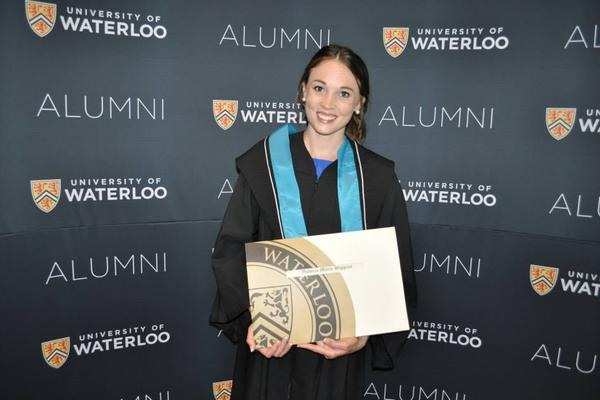 Victoria holding her diploma at convocation