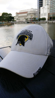 Warriors ball cap on a dock in Singapore