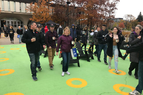Students and parents walking through the space
