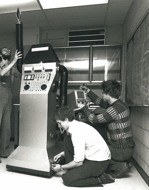 Students working on computer, historical