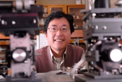 A photo of Pu Chen smiling for the camera in the lab.