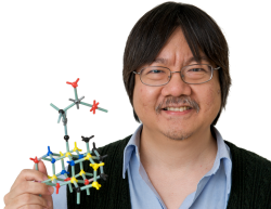 A photo of Tony Leung holding a molecule model.