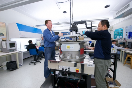 A photo of two researchers conducting an experiment in the Centre for Integrated Radio Frequency Engineering.