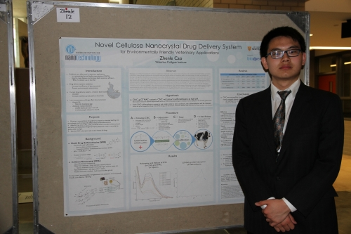 Zhenle Cao in front of his poster