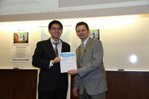 Zhenle Cao receiving his award plaque