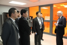 Dr Arthur Carty giving a tour of the Quantum Nano Centre to the Taiwanese delegation