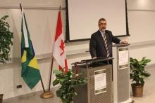 Dr Feridum Hamdullahpur speaking at the podium