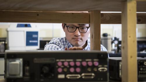 Adam Wei Tsen in the lab
