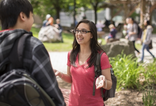 Girl talking with a student