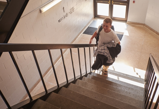 student climbing stairs