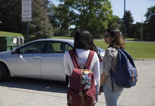 Students driving a car.