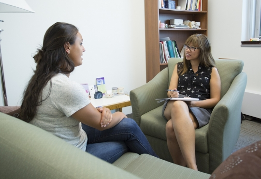 Student talking to a counselor.