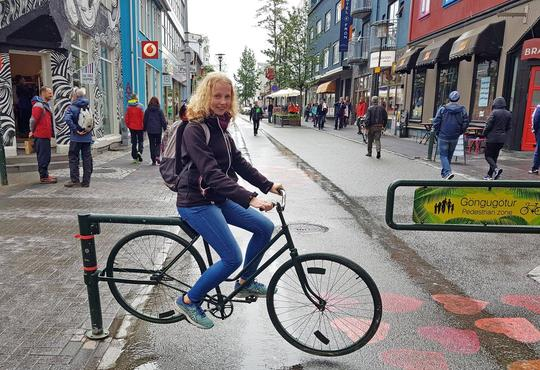 Katrine riding a bike.