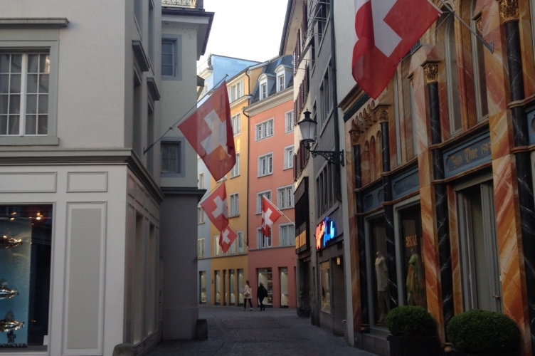 Swiss flags hanging from an street