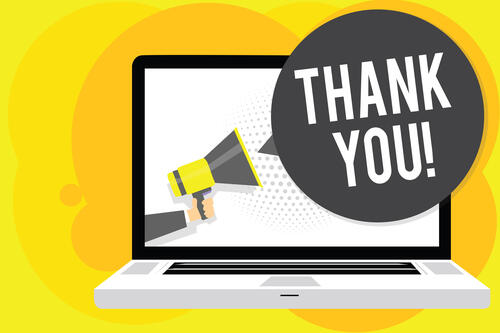 Laptop with speech bubble saying thank you