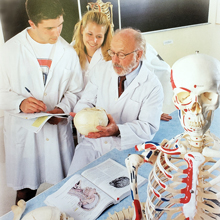 Dr. Donald Ranney with students in anatomy lab.