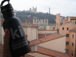 KI water bottle on window sill overlooking Lyon, France