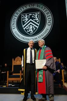 Ed Jernigan being present Honorary Member of the University by the Chancellor
