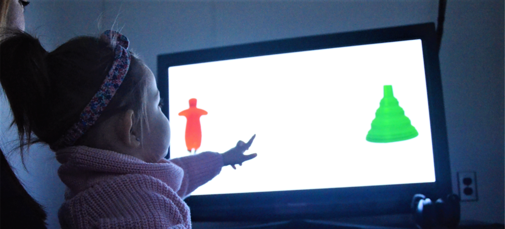 Little girl pointing at screen during a study