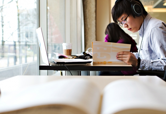 student studying at Dana Porter Library