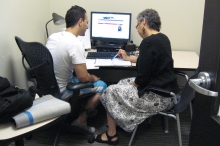 Janet Wason is helping a student in one of the study rooms.