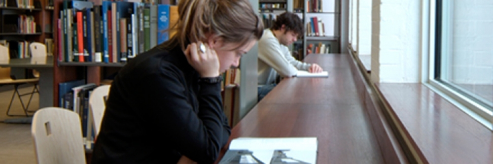 Students studying along the window wall in the Musagetes Library